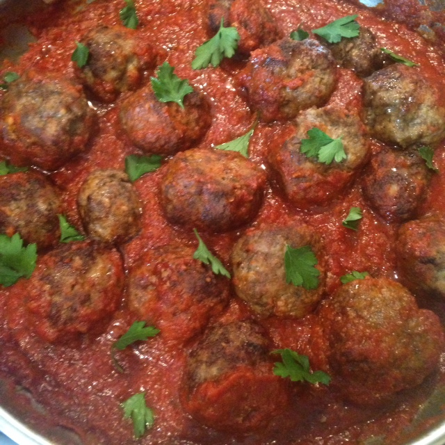 meatballs simmering in marinara