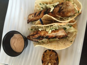 Mahi Mahi Tacos with jicama slaw, spicy aioli & grilled lemon.
