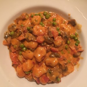 """South Beach Gnocchi"" gnocchi with peas, mushrooms, bacon in a pink sauce."
